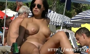 Sexy nudist women are captured on camera on a beach