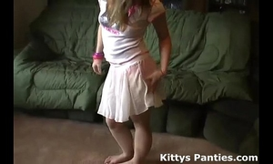 Petite legal age teenager kitty flashing her pants in a small miniskirt