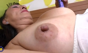 Busty older toying her hirsute wet crack