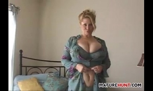 Busty aged golden-haired undresses and masturbates