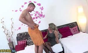 Blonde aged housewife engulfing off a juvenile chap