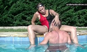 Submerged underwater with a jock inside her