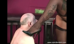 Ebony nylon dominatrix-bitch with serf