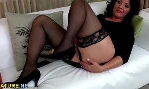 Black haired aged fingering herself in nylons