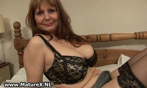 Ripe mature housewife with giant