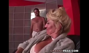 Busty grandma is getting her snatch stuffed