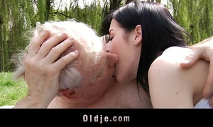 Young brunette hair wench bonks with older man in the park