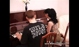 Mature lewd piano trainer fucking her student