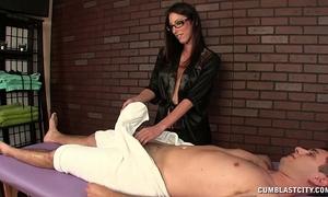 Hot brunette hair masseuse causes a large spunk fountain