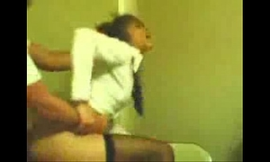 Girlfriend in school uniform acquires screwed doggy style