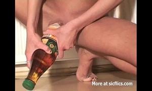 Skinny whore fucking massive bottles