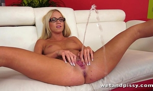 Pretty blond in glasses uses a jelly sex toy on her juicy cunt to agonorgasmos