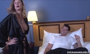 Sexy milf strokes a youthful penis