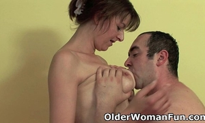 Mom takes a cum load in her throat