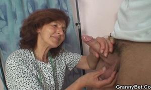 Sewing granny enjoys riding youthful wang