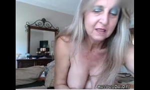 Hot breasty aged chick inserts anal plug and rubs cum-hole