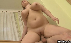 Busty plumper enjoys riding and engulfing his large rod