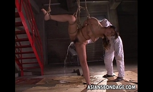 Kinky oriental playgirl in slavery acquires a naughty fake penis