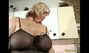 Blonde milf with extraordinary large natural scoops alone at home