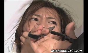 Cute oriental hottie in electro play slavery scene