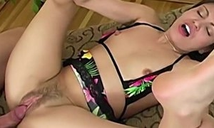 Dark-haired floozy in floral lingerie gets fucked balls deep